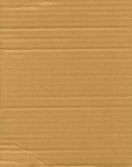 Коричневый гофрированный картон текстуры фона