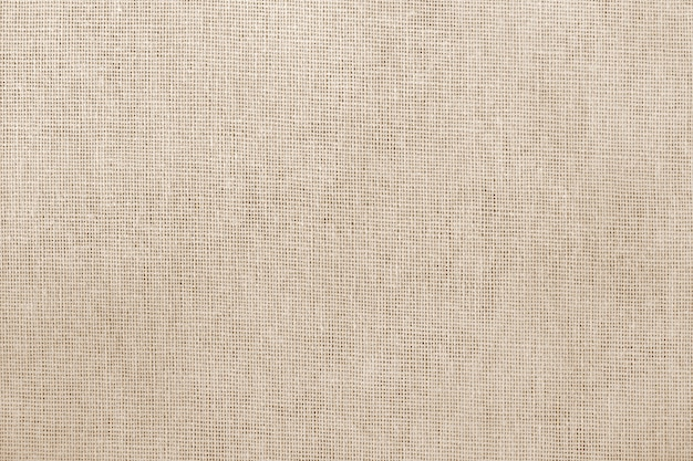 Brown cotton fabric texture background with seamless pattern.