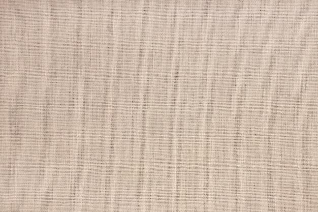 シームレスパターンを持つ茶色の綿生地のテクスチャです。