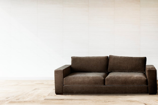 Brown couch against a white wall