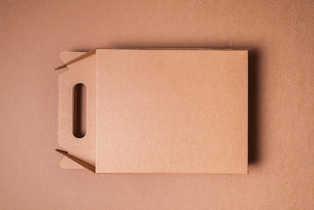 Brown craft cardboard box with handle