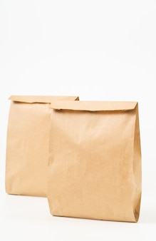 Brown craft paper bag for food packaging template isolated on white