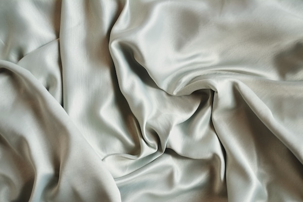 Brown cream satin or silk background with textile texture
