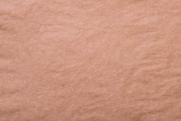 茶色のしわくちゃのベーキングペーパーテクスチャ背景