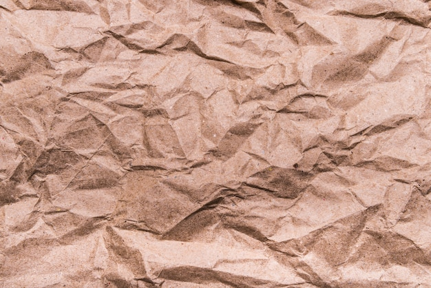 Brown crumpled craft paper texture, background