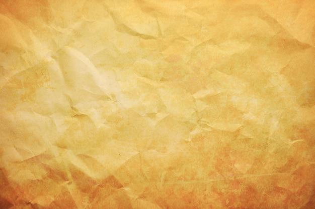 茶色のしわくちゃの包装紙テクスチャ背景