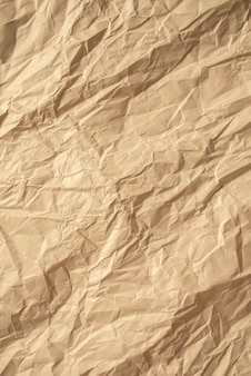 Brown crumpled paper close up texture background