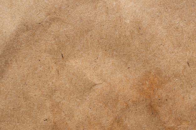 茶色のしわくちゃの紙リサイクルクラフトシートテクスチャ背景