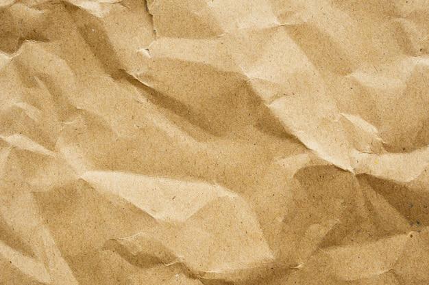茶色のしわくちゃ紙リサイクルクラフトシートテクスチャ背景