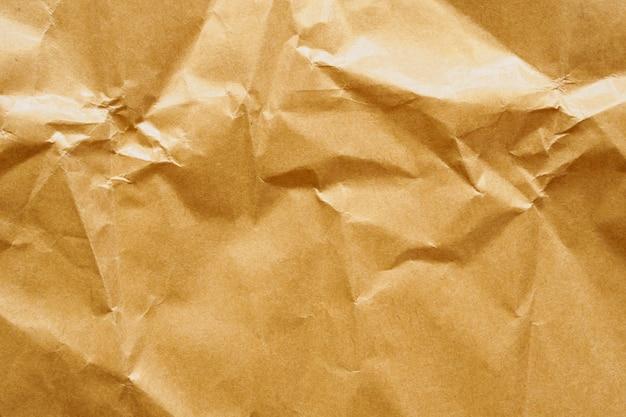 茶色のしわくちゃの紙リサイクルクラフトシートテクスチャ壁
