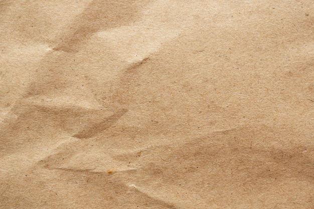 Brown crumpled paper recycled kraft sheet texture