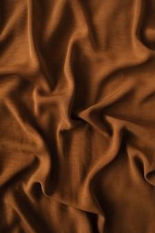 Brown crumpled satin textile background