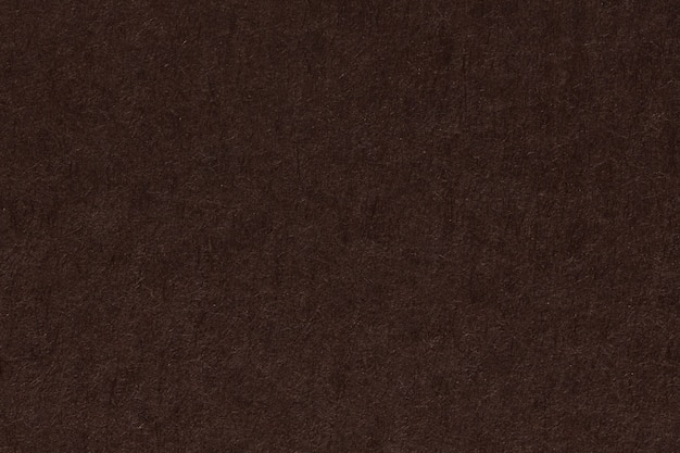 布朗黑暗的纸表面背景或纹理。高分辨率照片。