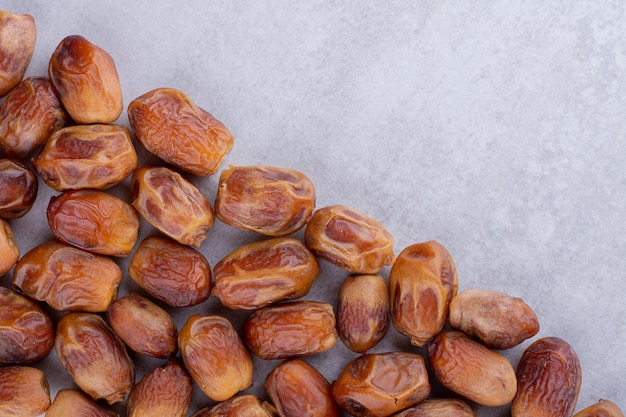 Brown dates isolated on concrete background. high quality photo