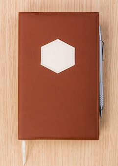 Brown diary with pen