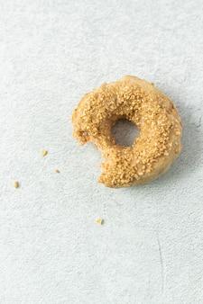 Brown doughnut on white textile