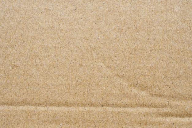 茶色のエコリサイクル段ボール紙シートテクスチャ壁
