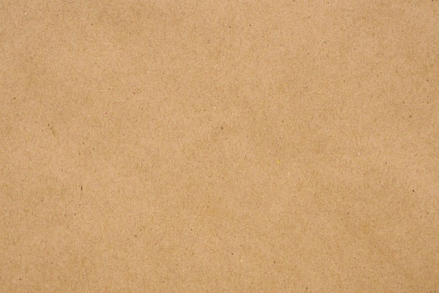 茶色のエコリサイクルクラフト紙シートテクスチャ段ボールの背景