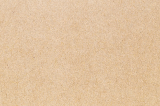 茶色のエコリサイクルクラフト紙シートテクスチャ段ボールの背景。