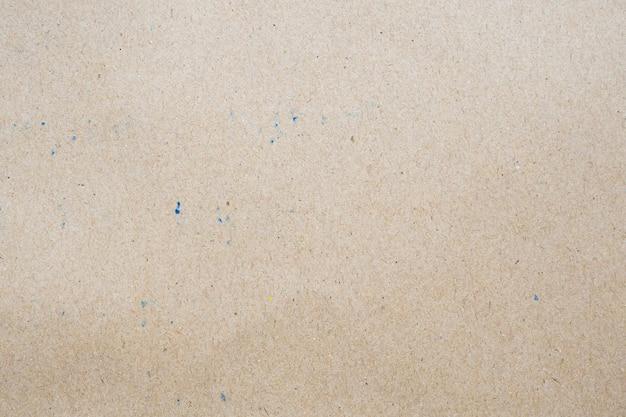 茶色のエコリサイクルクラフト紙シートテクスチャ段ボール壁