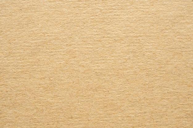 茶色のエコリサイクルクラフト紙テクスチャ段ボールの背景