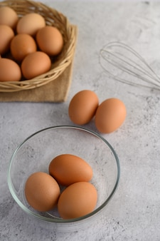 Brown eggs and glass bowl