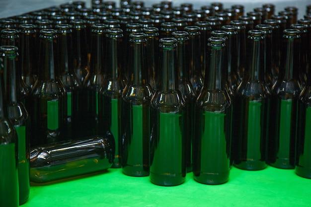 Brown empty bottles are prepared for bottling beer