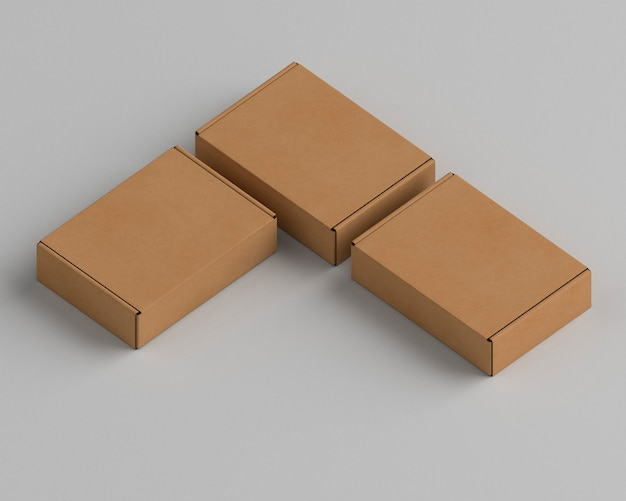 Brown empty simplistic cardboard boxes on grey background