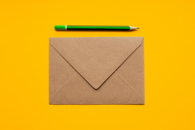 Brown envelope and simple green pencil