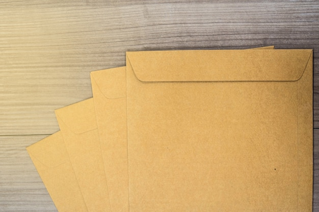 A brown envelope on a wooden floor surface