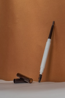 Brown eyebrow pencil on a brown background