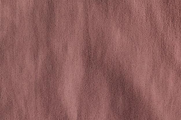 Предпосылка текстуры полиэстера ткани коричневой ткани.