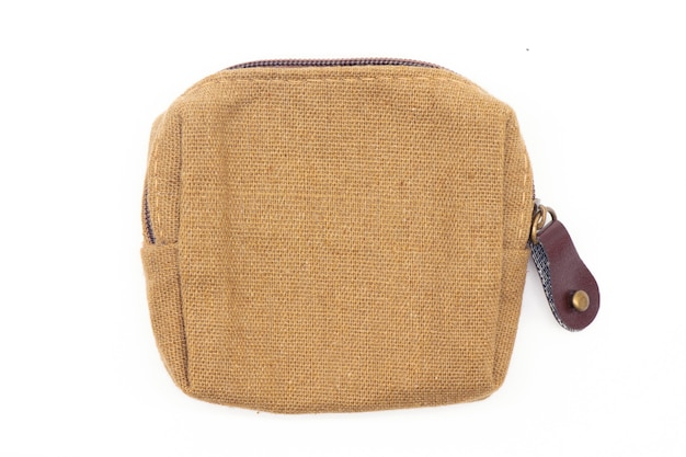Brown fabric coin purse isolated on white.