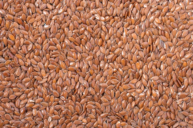 Brown flax seeds, background texture. organic superfood, top view