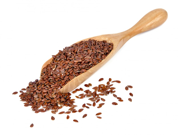 Brown flax seeds isolated on white