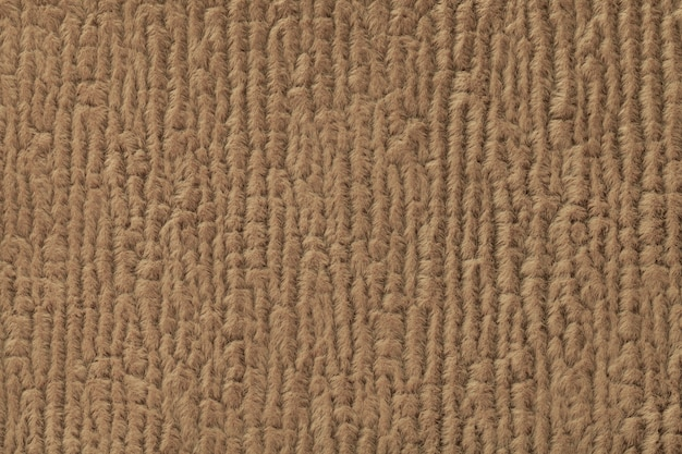 Brown fluffy background of soft, fleecy cloth. texture of textile closeup