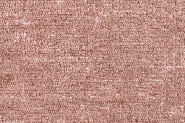Brown fluffy background of soft, fleecy cloth, texture of textile closeup