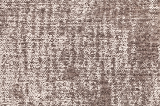 Brown fluffy background of soft, fleecy cloth