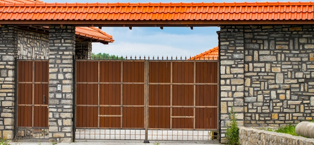 Brown forged automatic gates.
