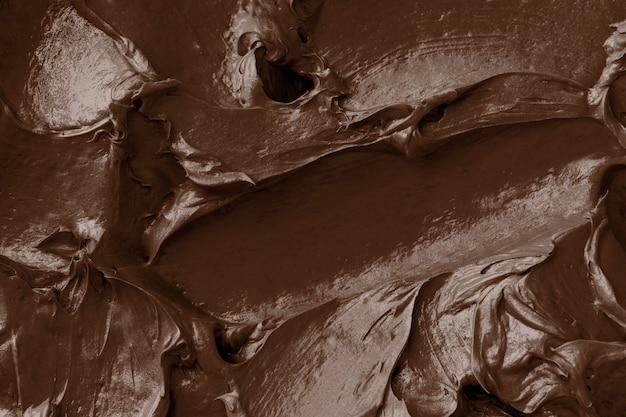 Brown frosting texture background close-up