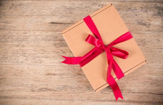 Brown gift box on brown wooden background