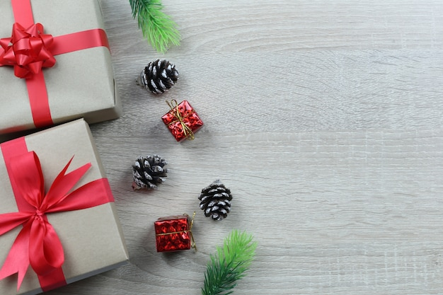 Brown gift box for christmas decoration on wooden floor.