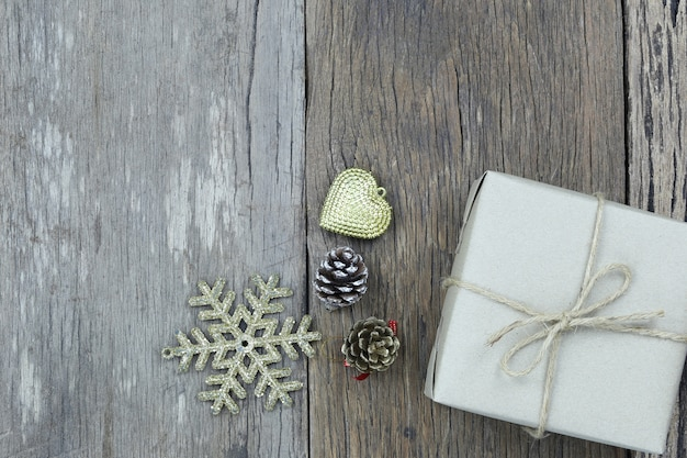 Brown gift box on wooden floor and have copy space.