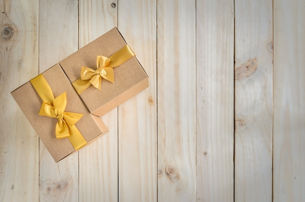 Brown gift boxes with gold bow