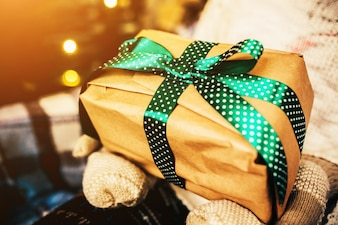 Brown gift with green bow