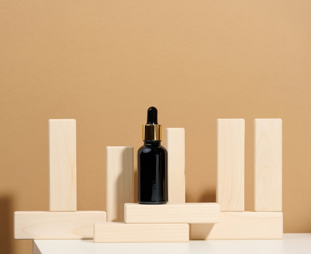 Brown glass bottle with pipette stands on a white table. cosmetics spa branding. packaging for gel, serum, advertising and product promotion, mock up