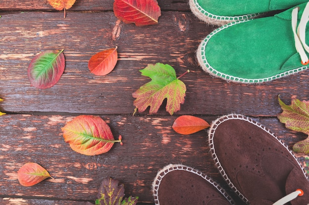 Brown and green man suede boots espadrilles on wood