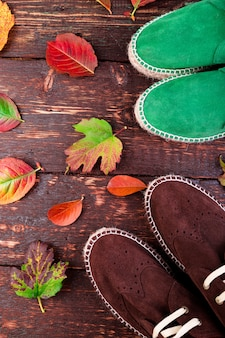 Brown and green man suede boots espadrilles on wooden