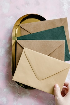 Brown and green paper envelopes