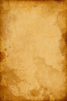 Brown grunge  texture of old vintage paper in spots with space for text